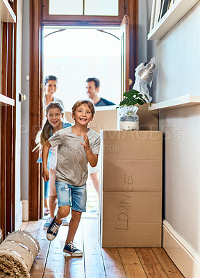Buy stock photo Shot of a cheerful young boy and girl running in a hallway in their new home while having fun inside during the day