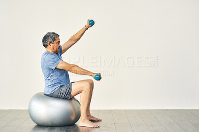 Buy stock photo Full length shot of a senior male going through his physiotherapy routine