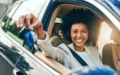 Buy stock photo Portrait of a cheerful young woman driving in her car to work while holding a set of keys during the day