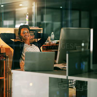 Buy stock photo Portrait of a young businesswoman taking a break while working late in an office