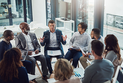 Buy stock photo High angle shot of a group of white collar businesspeople meeting in the boardroom