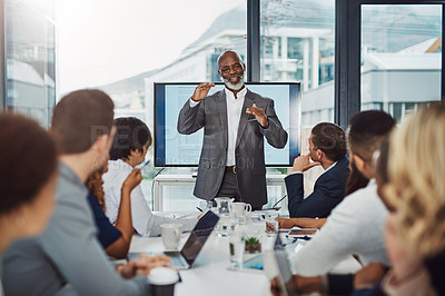Buy stock photo Cropped shot of a handsome businessman giving a presentation in the boardroom