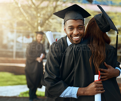 Buy stock photo Portrait of a happy young man and woman hugging on graduation day