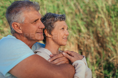 Buy stock photo Shot of a affectionate mature couple spending time together outdoors