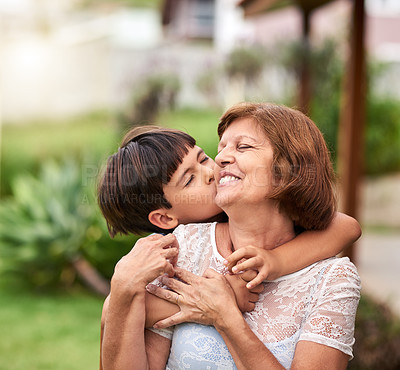 Buy stock photo Cropped shot of an adorable little boy spending quality time with his grandmother