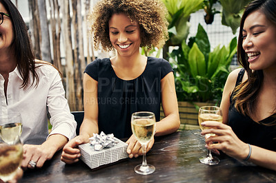 Buy stock photo Cropped shot of female friends spending time together at a restaurant outside