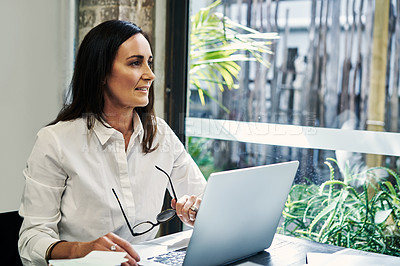 Buy stock photo Cropped shot of a businesswoman using a laptop in a restaurant