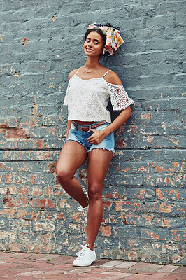 Buy stock photo Shot of an attractive  young woman posing against a brick wall outside