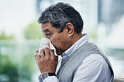 Buy stock photo Shot of a mature man blowing his nose