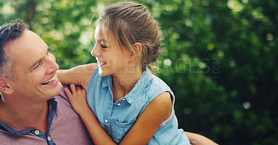 Buy stock photo Shot of an affectionate little girl spending quality time with her father outdoors