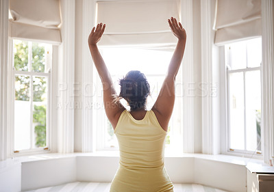 Buy stock photo Shot of a beautiful young woman stretching in her bedroom at home
