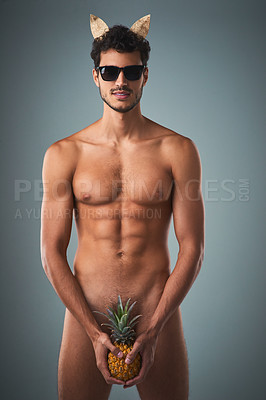 Buy stock photo Studio shot of a handsome young shirtless man posing against a grey background