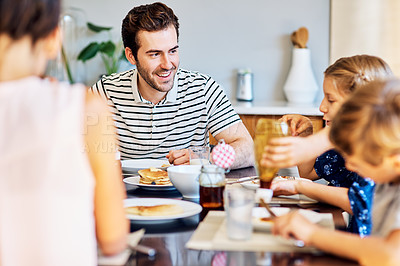 Buy stock photo Shot of a family having breakfast together at home