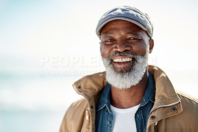 Buy stock photo Portrait of a mature man enjoying a day at the beach