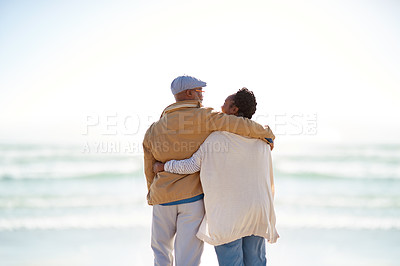 Buy stock photo Rearview shot of a mature couple enjoying some quality time together at the beach