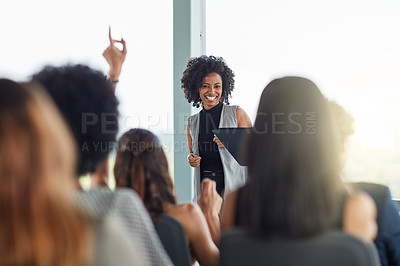 Buy stock photo Cropped shot of an attractive young businesswoman speaking at a business conference