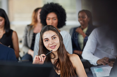 Buy stock photo Cropped shot of an attractive young businesswoman looking thoughtful while attending a seminar