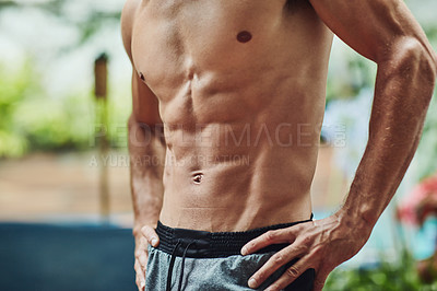 Buy stock photo Cropped shot of an unrecognizable shirtless man at home