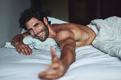 Buy stock photo Cropped shot of a handsome young shirtless man lying in bed at home