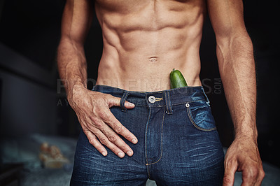 Buy stock photo Cropped shot of an unrecognizable shirtless man with a cucumber in his pants at home
