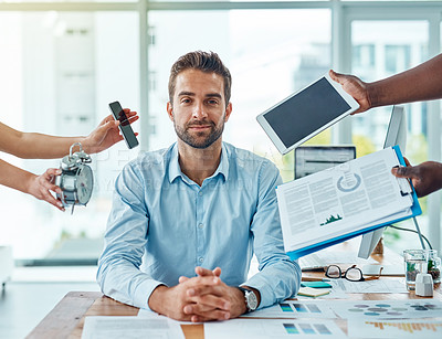Buy stock photo Portrait of a young businessman looking calm in a demanding office environment
