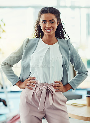 Buy stock photo Sho of an attractive young business owner working in her clothing boutique