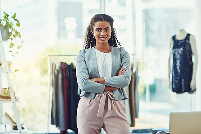 Buy stock photo Shot of an attractive young business owner working in her clothing boutique