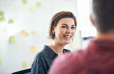 Buy stock photo Shot of a happy young businesswoman having a meeting with a colleague in a modern office