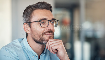 Buy stock photo Shot of a handsome mature businessman looking thoughtful in a modern office