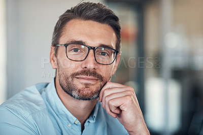 Buy stock photo Portrait of a confident and handsome mature businessman working in a modern office