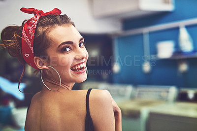 Buy stock photo Rearview portrait of an attractive young woman standing inside of a laundry room to do washing while looking back at the camera