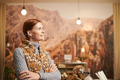 Buy stock photo Shot of an entrepreneurial middle aged woman working in a store