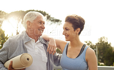 Buy stock photo Cropped shot of a senior man getting ready to workout   with a female instructor at home
