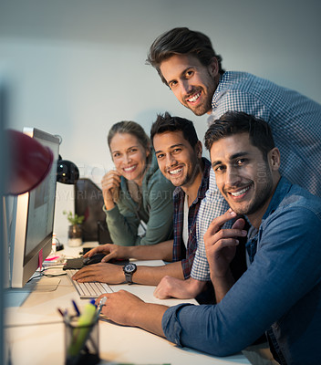 Buy stock photo Portrait of a group of designers working together on a computer in an office