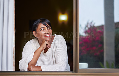 Buy stock photo Shot of a mature woman relaxing at home