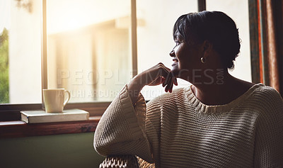 Buy stock photo Shot of a mature woman looking out the window at home