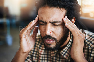 Buy stock photo Cropped shot of a young male designer looking completely stressed out while sitting in his office