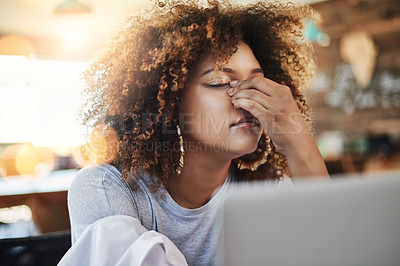 Buy stock photo Cropped shot of a young female designer looking completely stressed out while sitting in her office