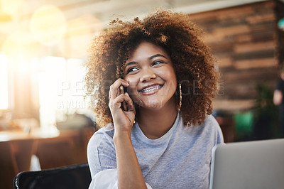 Buy stock photo Cropped shot of an attractive young female designer making a call while sitting in her office