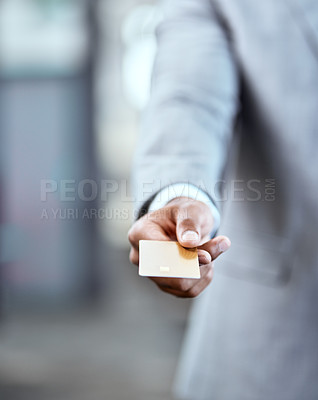 Buy stock photo Closeup shot of an unrecognizable businessman holding a credit card in an office