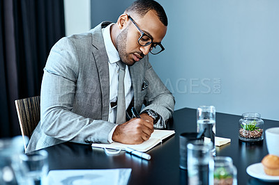 Buy stock photo Studio shot of a young businessman working against a grey background