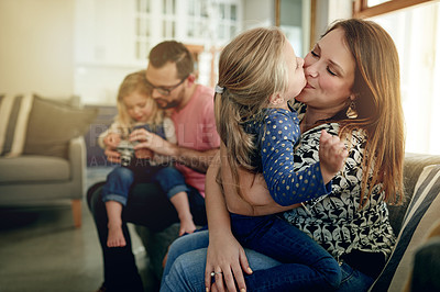 Buy stock photo Shot of a young family spending time together at home