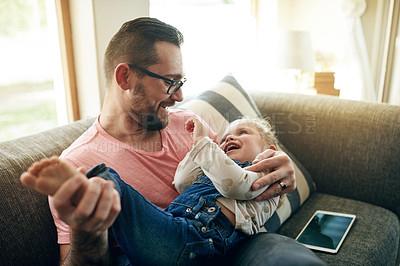 Buy stock photo Shot of a father and his little girl spending time together at home
