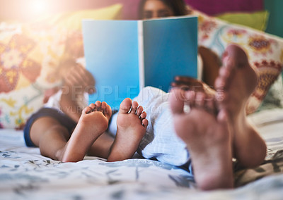 Buy stock photo Closeup shot of a mother and her little daughter's bare feet at home
