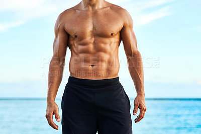 Buy stock photo Closeup shot of a shirtless and muscular young man standing outdoors