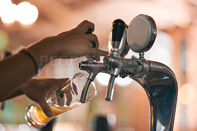 Buy stock photo Shot of an unrecognizable person pouring a beer from a tap inside of a beer brewery during the day