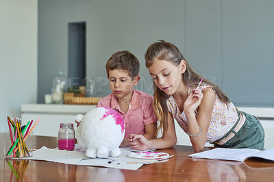 Buy stock photo Shot of two adorable little siblings painting together at home