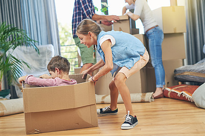 Buy stock photo Shot of a happy brother and sister having fun together on moving day
