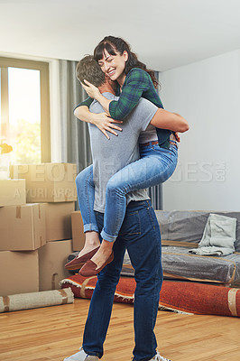 Buy stock photo Shot of a happy couple embracing in their home on moving day