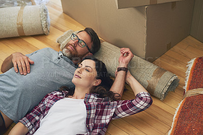 Buy stock photo Shot of a couple relaxing together in their home on moving day
